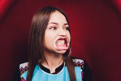 Close up of female mouth with retractor. Doctor flossing the teeth. Dental Gag. Close up of female mouth with retractor. Doctor flossing the teeth. Dental Gag stock photography