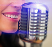 Close-up of female mouth singing. Stock Images