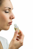 Close-up of female patient with eyes closed while smelling bottle of medicine Royalty Free Stock Images