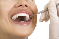Close-up of female patient having her teeth examined by dentist royalty free stock images