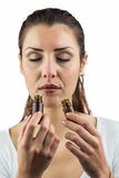 Close-up of female patient smelling bottles of medicine Royalty Free Stock Images