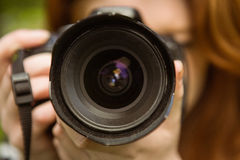 Close up of female photographer Royalty Free Stock Photography