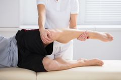 Close-up Of Physiotherapist Giving Exercise stock photography