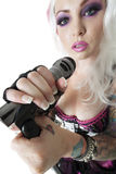 Close-up of female punk holding microphone over white background Stock Photography