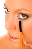 Close up of female putting liner Stock Photography