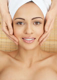 Close-up of a female receiving facial massage Stock Images