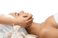 Close-up of a female receiving facial massage Royalty Free Stock Images