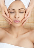 Close-up of a female receiving facial massage Royalty Free Stock Photography