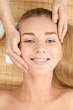 Close-up of a female receiving facial massage Royalty Free Stock Image