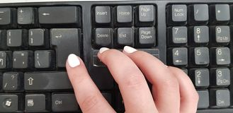 Close up of female right hand pressing enter key stock photos