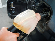 Free Close Up Female`s Hand Pumping Fuel By Dispenser In Cars At Gas Station.Transportation Concept Stock Photos - 97371573