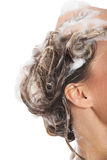 Close up on female's head with shampoo. Stock Photography