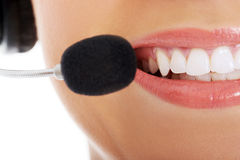 Close up on female's mouth with microphone. Stock Images