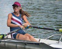 Close up of Female Sculler in blue on the River Ouse. Stock Photo