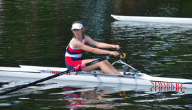 Close up of Female Sculler, Newark Club on the River Ouse at St Neots. Royalty Free Stock Photography