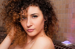 Close-up of female with sexy look relaxing in wet sauna Royalty Free Stock Photos