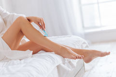 Close up of female that shaving her legs royalty free stock images
