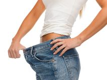 Close up of female showing big jeans Royalty Free Stock Photos
