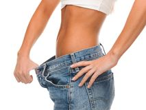 Close up of female showing big jeans Stock Photos