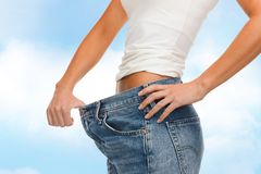 Close up of female showing big jeans Stock Images