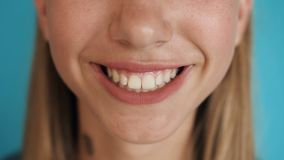 Close up of female smile with white healthy teeth, fashion model clean smile with perfect teeth. Extreme close up stock video