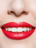 Close up of female smiling red lips Stock Photo