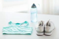 Close up of female sports clothing and bottle set Royalty Free Stock Photo