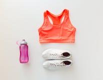 Close up of female sports clothing and bottle set Stock Image