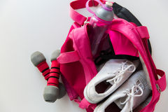 Close up of female sports stuff in backpack Royalty Free Stock Images