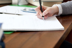 Close-up of a female student doing her homework Royalty Free Stock Images