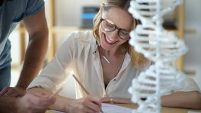 Close up of female student studying genetics with groupmate