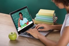 Student Video Conferencing With Teacher On Laptop royalty free stock image