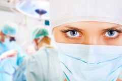 Close-up of a female surgeon with his team Royalty Free Stock Image