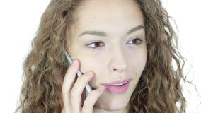 Close Up, Female Talking On Smartphone, White Background,Young,,,,. Close Up, Female Talking On Smartphone, White Background , young creative designer , good stock footage