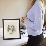 Close Up Of Female Teenage Artist Framing Charcoal Drawing Of Dog In Studio royalty free stock images
