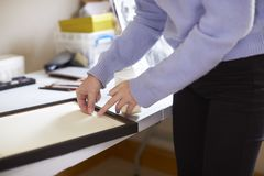 Close Up Of Female Teenage Artist Framing Picture In Studio royalty free stock photo