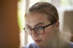 Close Up Of Female Teenage Artist Working Behind Easel stock photo