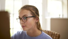 Close Up Of Female Teenage Artist Working Behind Easel royalty free stock images