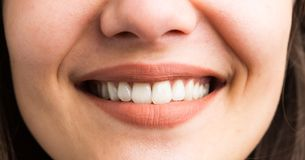 Close-up of female teeth smile. Close-up of beautiful female teeth smile as natural perfect healthy hygiene concept Stock Images