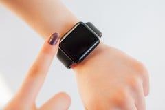 Close up female touching screen of smart wrist watch Royalty Free Stock Image