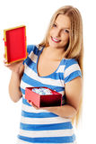 Close-up of female unpacking a present Stock Photography