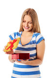 Close-up of female unpacking a present Stock Photos