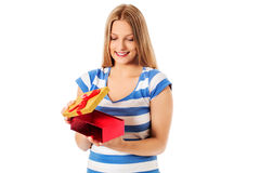 Close-up of female unpacking a present Stock Images
