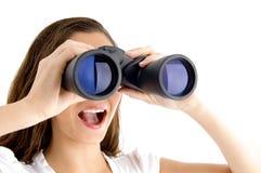 Close up of female watching through binocular Royalty Free Stock Photo