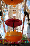 Close up of ferris wheel. Colorful cars on a ferris wheel in close up Stock Photography
