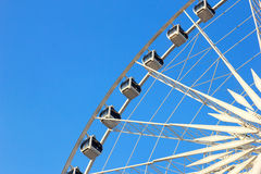 Close up of ferris wheel with blue sky Stock Image