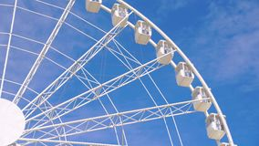 Close-up of a ferris wheel spinning in 4K stock video footage