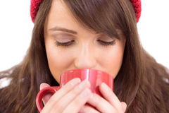 Close up of a festive brunette drinking from mug Royalty Free Stock Photo
