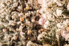 Close up. Festive christmas background. Ornate decorated Christmas tree, strewn with garlands of lights