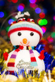 Close-up festive snowman with Christmas blurred lights background Stock Images